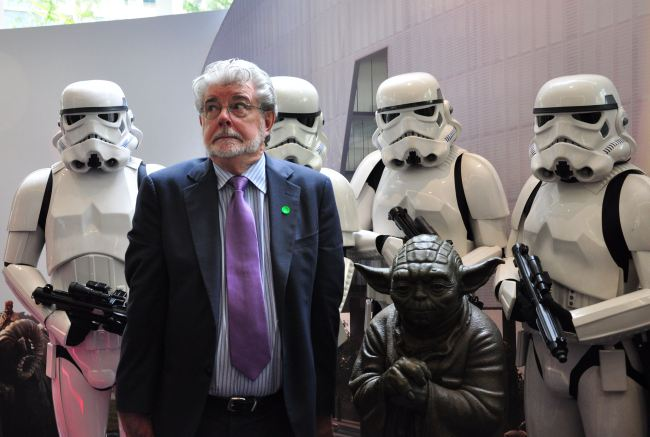 Filmmaking legend George Lucas (front L)